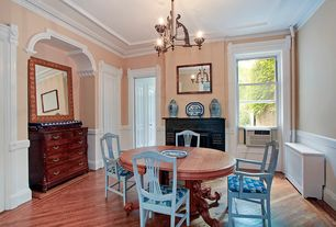 Traditional Dining Room with Built-in bookshelf, Crown molding, Chair rail, Chandelier, Hardwood floors