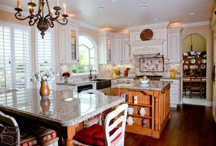 Country Kitchen with Simple granite counters, Flat panel cabinets, Crown molding, Glass panel, Slate Tile, Kitchen island