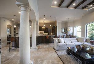 Mediterranean Great Room with Crown molding, stone tile floors, Chandelier, Pendant light, Standard height, Columns