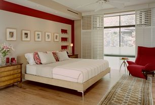 Contemporary Guest Bedroom with Ceiling fan, Hardwood floors, Built-in bookshelf