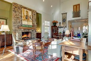 Rustic Great Room with can lights, Chandelier, French doors, stone fireplace, Fireplace, Balcony, Casement, High ceiling