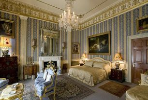 Traditional Master Bedroom with Chandelier, interior wallpaper, Cement fireplace, High ceiling, Fireplace, six panel door