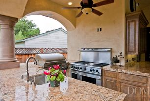 Mediterranean Porch with Covered patio, Paint, Granite countertop, in juparana persia, Outdoor kitchen, Fence