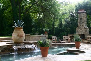Traditional Patio with Pathway, Fence, exterior stone floors, Pool with hot tub, Fountain