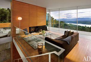 Modern Living Room with Flos Glo Ball F1 Floor Lamp, Blu Dot Bonnie Sofa, Modloft Mayfair Lounge Chair, Knoll barcelona table