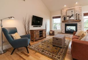 Country Living Room with Ceiling fan, can lights, High ceiling, metal fireplace, Hardwood floors, Fireplace
