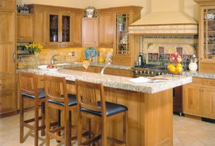Craftsman Kitchen with Undermount sink, Standard height, Kitchen peninsula, can lights, Stone Tile, Limestone Tile, L-shaped