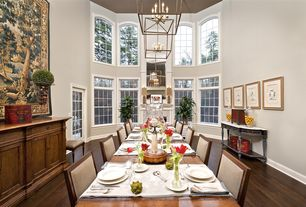 Traditional Dining Room with Glass panel door, stone fireplace, Cathedral ceiling, Chandelier, Arched window, Hardwood floors