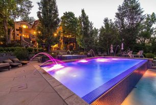 Contemporary Swimming Pool with exterior tile floors, Pathway, Raised beds, Lap pool, Casement, Fountain, Fence