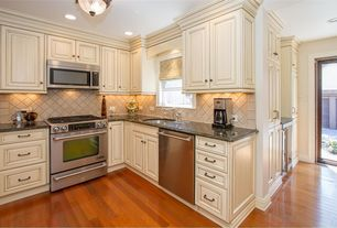 Traditional Kitchen with Simple granite counters, Stone Tile, L-shaped, Limestone Tile, Flush, Hardwood floors, French doors
