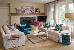 Contemporary Living Room with French doors, Built-in bookshelf, Nova Veld Floor Lamp, stone fireplace, Carpet