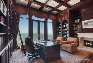 Traditional Home Office with Cement fireplace, Crown molding, Box ceiling, Built-in bookshelf, Transom window, French doors
