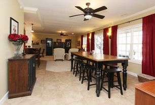 Traditional Dining Room with travertine floors, Crown molding, Wall sconce, Ceiling fan