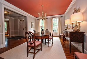 Traditional Dining Room with Hardwood floors, Crown molding, Chandelier, Chair rail