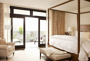 Contemporary Master Bedroom with Transom window, Laminate floors