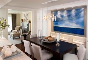 Traditional Dining Room with Built-in bookshelf, Standard height, Crown molding, Hardwood floors, Pendant light, can lights