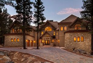 Country Exterior of Home with Arched window, Stacked stone, Pavers, Glass panel door, Pathway