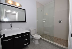 Contemporary 3/4 Bathroom with Vessel sink, limestone tile floors, European Cabinets, specialty door, Flush, Corian counters