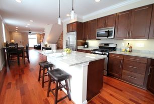 Contemporary Kitchen with Breakfast bar, One-wall, European Cabinets, partial backsplash, Crown molding, Flat panel cabinets
