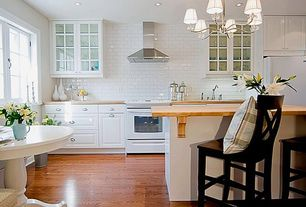 Traditional Kitchen with One-wall, Subway Tile, Kitchen island, European Cabinets, Window seat, Wood counters, Breakfast nook