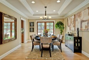 Traditional Dining Room with Chandelier, can lights, Standard height, Crown molding, French doors, Hardwood floors