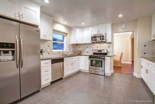 Contemporary Kitchen with Standard height, stone tile floors, gas range, Subway Tile, double-hung window, U-shaped