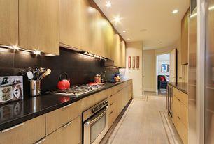 Modern Kitchen with European Cabinets, Undermount sink, Simple granite counters, Wine refrigerator, Simple Granite Tile