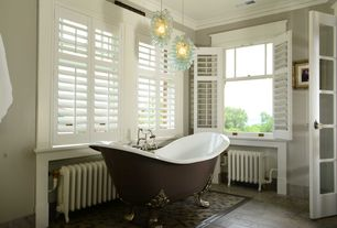Country Master Bathroom with Crown molding, Clawfoot, Pendant light, French doors, Master bathroom