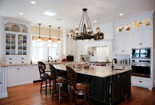 Traditional Kitchen with wall oven, Undermount sink, Standard height, L-shaped, Kitchen island, Breakfast bar, can lights