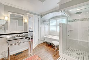 Traditional Full Bathroom with White subway tile, Hardwood floors, frameless showerdoor, Wall sconce, Console sink, Clawfoot
