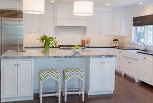 Traditional Kitchen with Kitchen island, Undermount sink, Custom hood, L-shaped, Crown molding, Soapstone counters