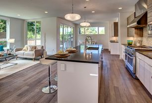 Modern Kitchen with Chandelier, Standard height, Kitchen island, Glass top chrome x base coffee table, Breakfast nook, Flush