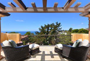 Mediterranean Deck with Stucco, Trellis, exterior stone floors, Paint, Deck Railing, Outdoor wicker chair