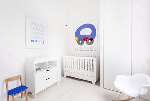 Contemporary Kids Bedroom with Hardwood floors, Eames? Molded Plastic Rocker (RAR), Built-in bookshelf