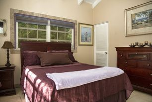 Traditional Guest Bedroom with Louvered door, Exposed beam, limestone tile floors