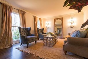 Eclectic Living Room with Wholesale interiors baxton studio chair, Wall sconce, Anji Mountain Kashmir Rug, Crown molding