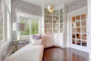 Traditional Family Room with French doors, Pendant light, Hardwood floors, Built-in bookshelf, interior wallpaper