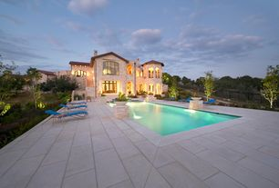 Contemporary Swimming Pool with exterior tile floors, Fence, Fountain, Pool with hot tub, Lap pool, Pathway, Transom window