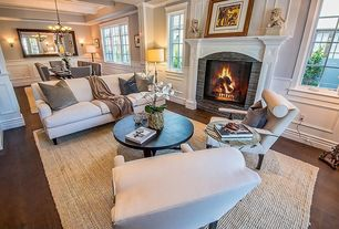 Traditional Living Room with Standard height, Casement, Hardwood floors, Fireplace, Crown molding, Wainscotting