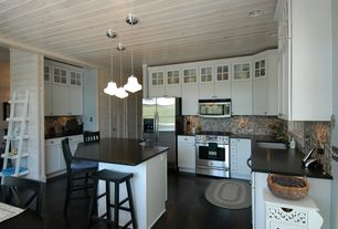 Country Kitchen with Soapstone counters, Pendant light, Flush, specialty door, Ms international absolute black granite
