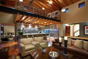Modern Great Room with Exposed beam, Fireplace, Pendant light, can lights, Columns, Hardwood floors, picture window, Loft
