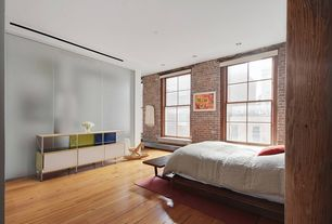 Eclectic Guest Bedroom with Standard height, double-hung window, interior brick, can lights, Hardwood floors