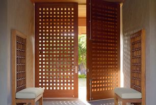 Tropical Entryway with can lights, Concrete tile , High ceiling, specialty door