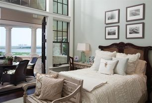 Traditional Master Bedroom with picture window, High ceiling, double-hung window, Hardwood floors, Paint, Transom window
