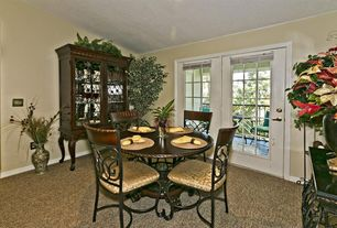 Traditional Dining Room with Carpet, Standard height, French doors