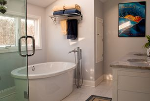 Contemporary Master Bathroom with High ceiling, Flat panel cabinets, Skylight, Double sink, Undermount sink, Freestanding