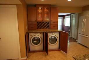 Craftsman Laundry Room with Undermount sink, laundry sink, can lights, flat door, Standard height, sandstone tile floors