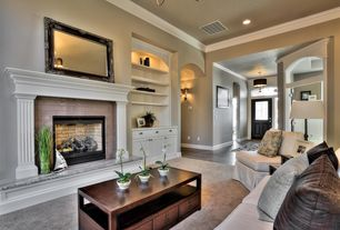 Traditional Living Room with brick fireplace, can lights, Crown molding, Carpet, Fireplace, Standard height, Chandelier