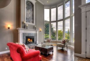 Traditional Living Room with stone fireplace, Crown molding, Slate fireplace, Hardwood floors, interior wallpaper