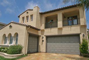 Mediterranean Garage with sandstone floors, double-hung window, Casement, Wall sconce, Barn door, Standard height